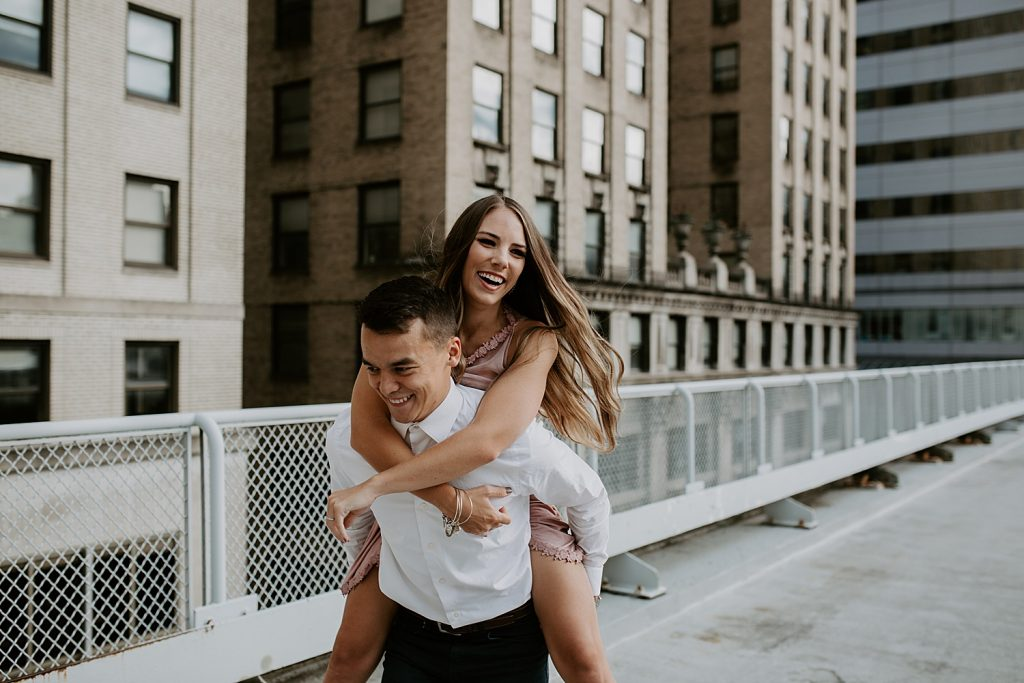 Downtown Pittsburgh Rooftop Engagement Session. For more city engagement session ideas, visit burghbrides.com!