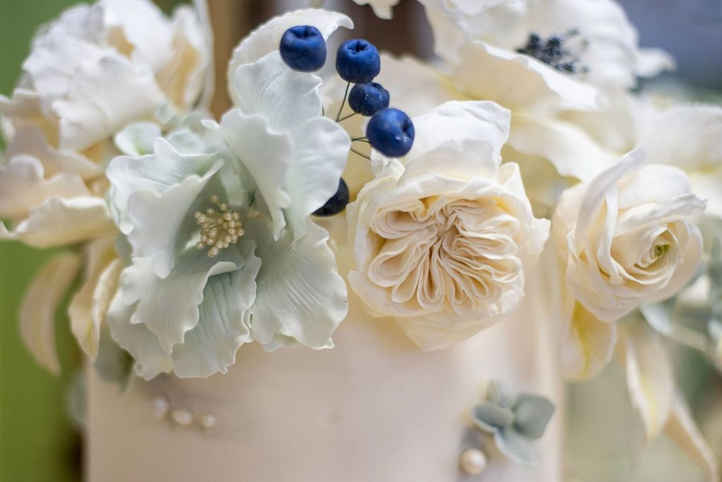 4 Reasons to Consider Sugar Flowers on Your Wedding Cake. For more wedding cake tips, visit burghbrides.com!