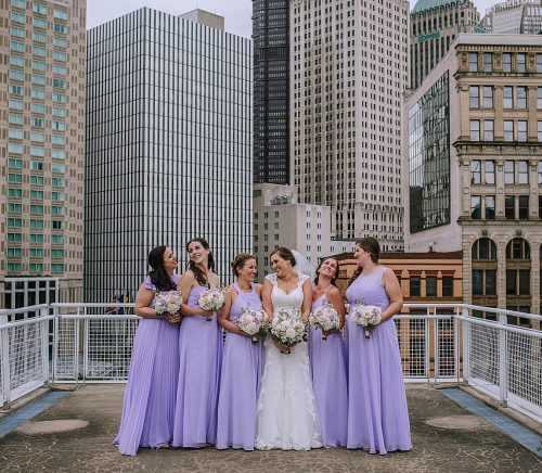 Gorgeous Downtown Rooftop Wedding. For more purple wedding ideas, visit burghbrides.com!