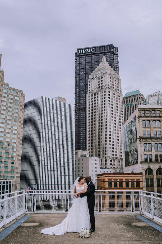 Gorgeous Downtown Rooftop Wedding. For more purple wedding ideas, visit burghbrides.com!