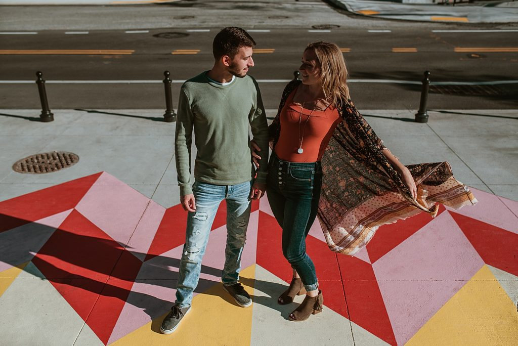 Cool & Colorful Downtown Pittsburgh Engagement Session. For more casual engagement photo ideas, visit burghbrides.com!